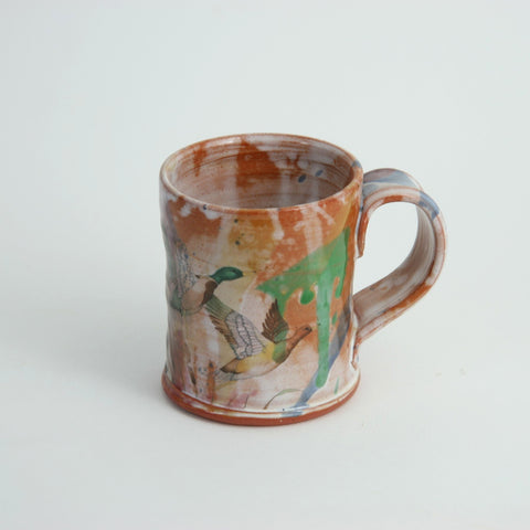 Orange Decal Mugs by Justin Rothshank