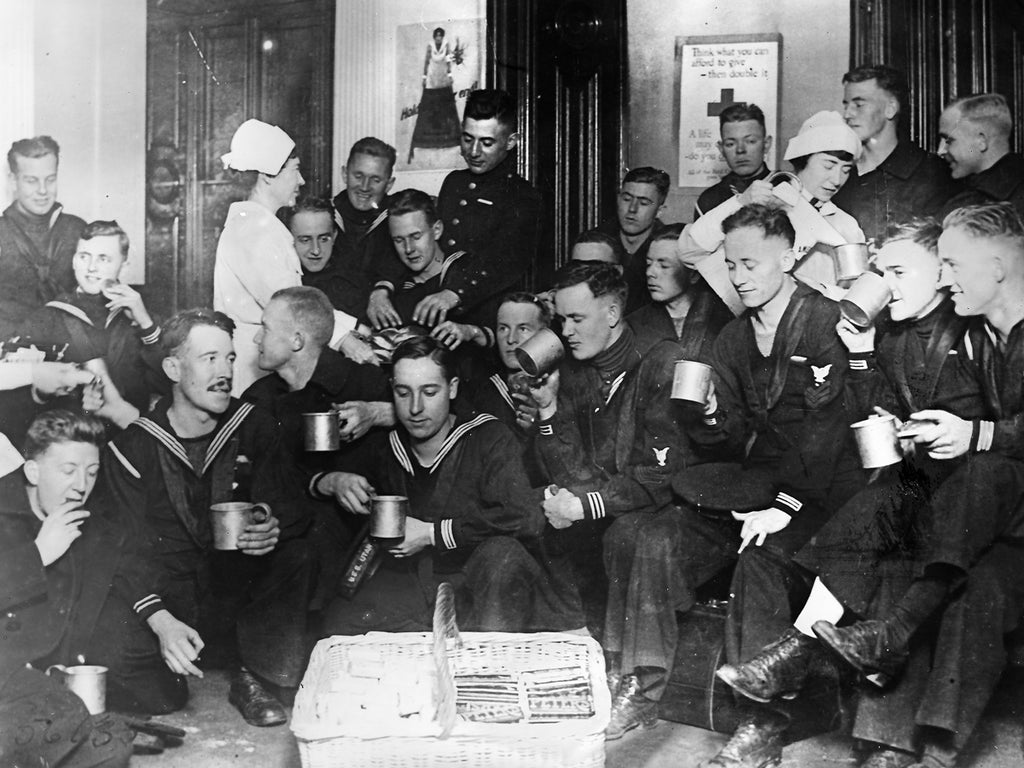 A roomfull of sailors at RC headquarters in London drinking coffee