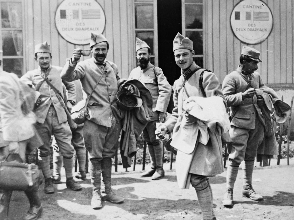 French soldiers drinking coffee served by the American Red Cross