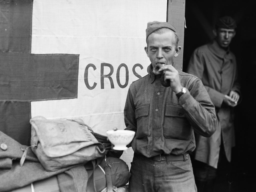 Coffee and doughnuts for a hungry soldier at the Red Cross Canteen Saint Pierre des Corps