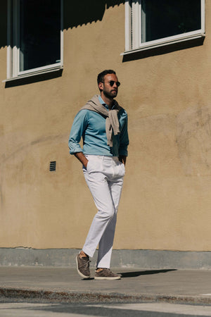 White pair of regular fit cotton trousers