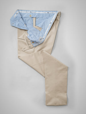 Beige pair of regular fit cotton trousers