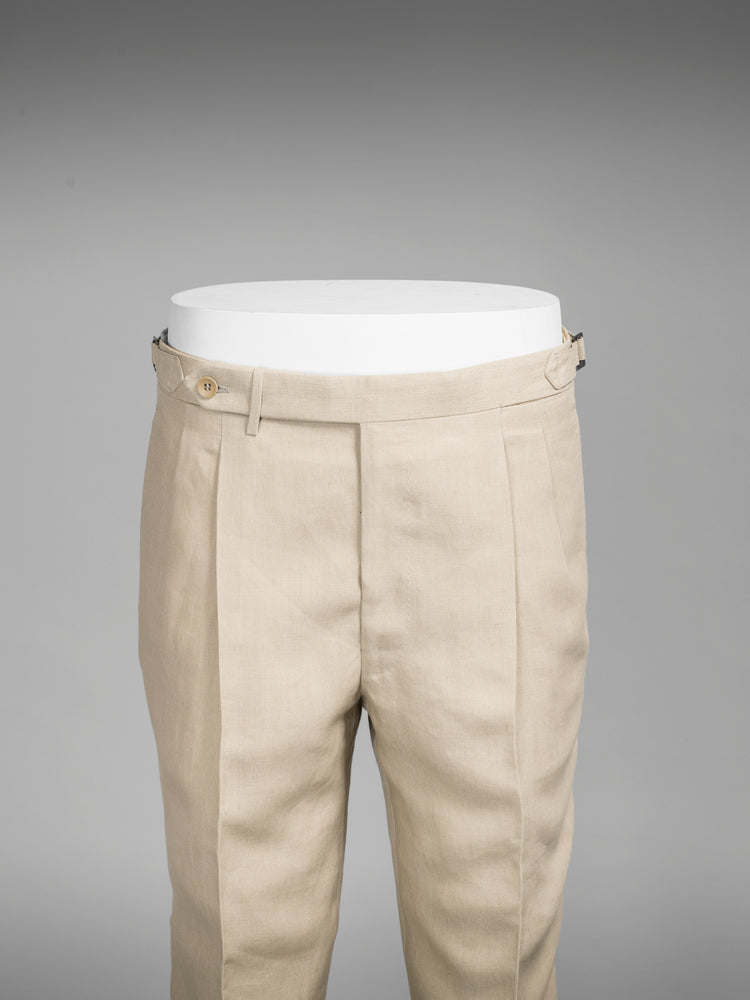 Beige pair of regular fit linen trousers