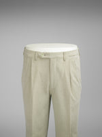 Light beige pair of regular fit cotton trousers
