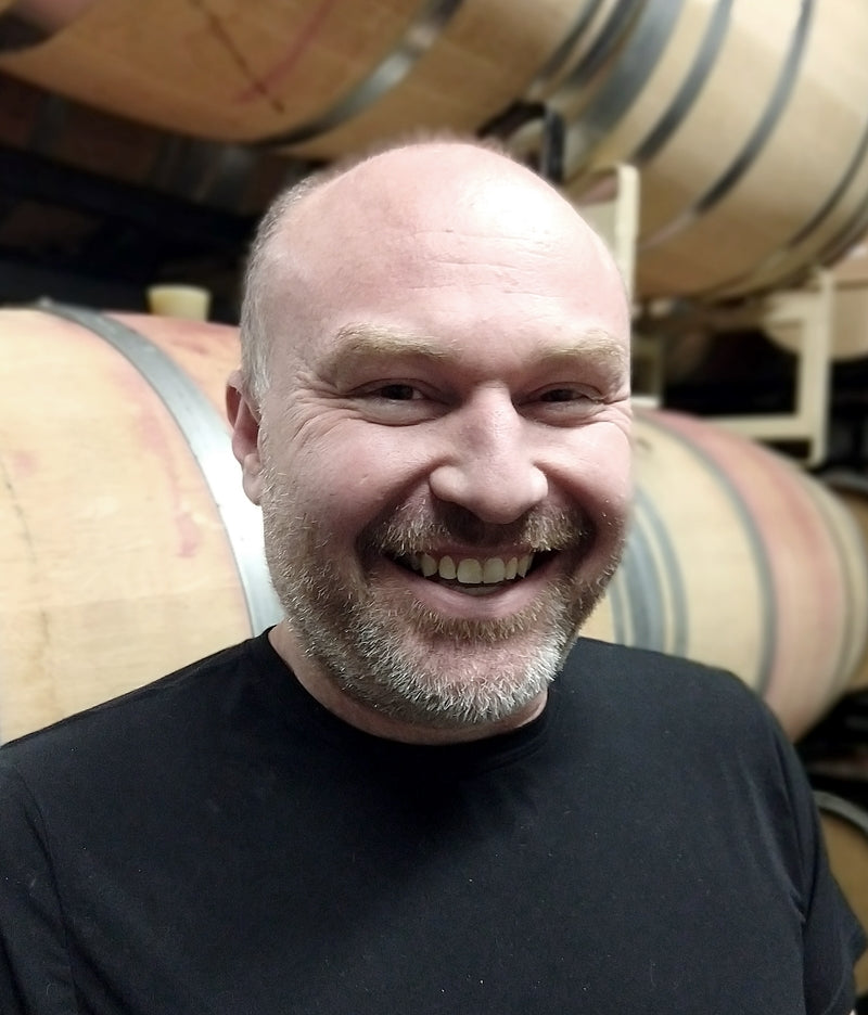 Jason Smith Winemaker Smiling Barrels