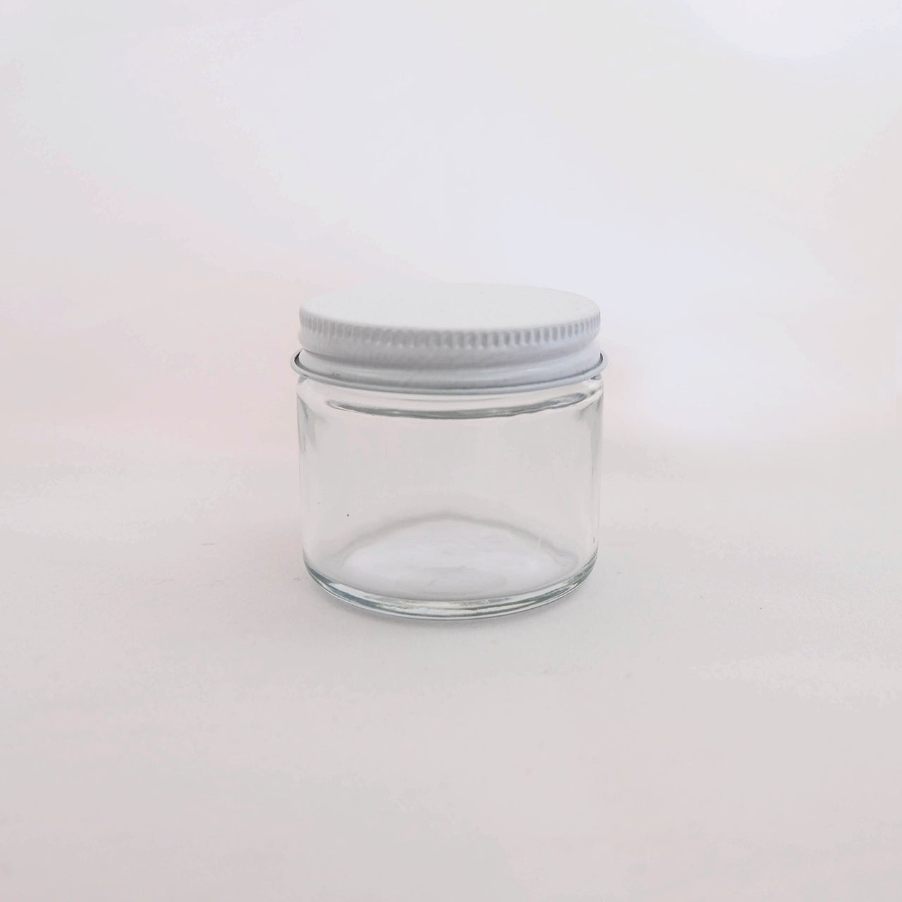 2 oz. Glass Jar with White Metal Screw Lid