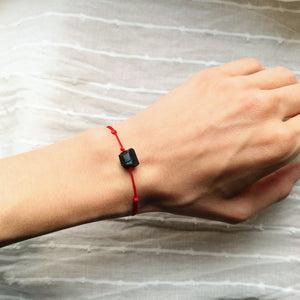 Black tourmaline bracelet with red cord