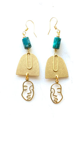 Brass earrings with  turquoise stone and face on the bottom.