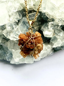 close up of aragonite brass pendant by full moon designs, a handmade necklace