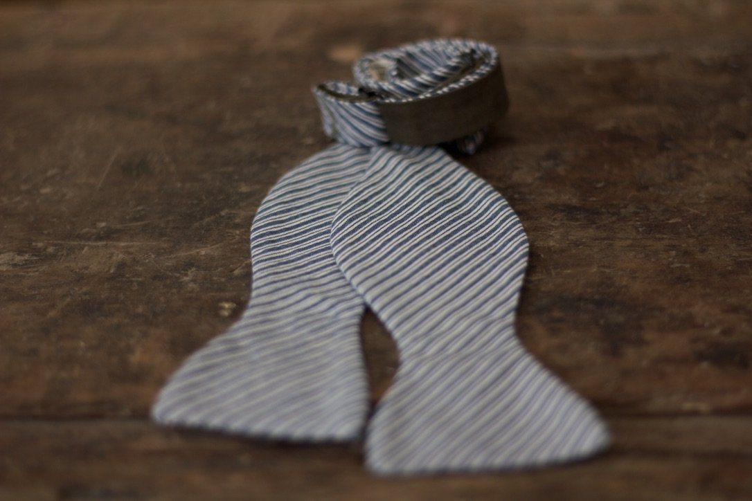 Noodles Bow Ties 100% Cotton  Blue and white Handcrafted in Italy coated metal hardware  olive green gabardine inside hand-stitched labels handmade boxes self-tie bow ties