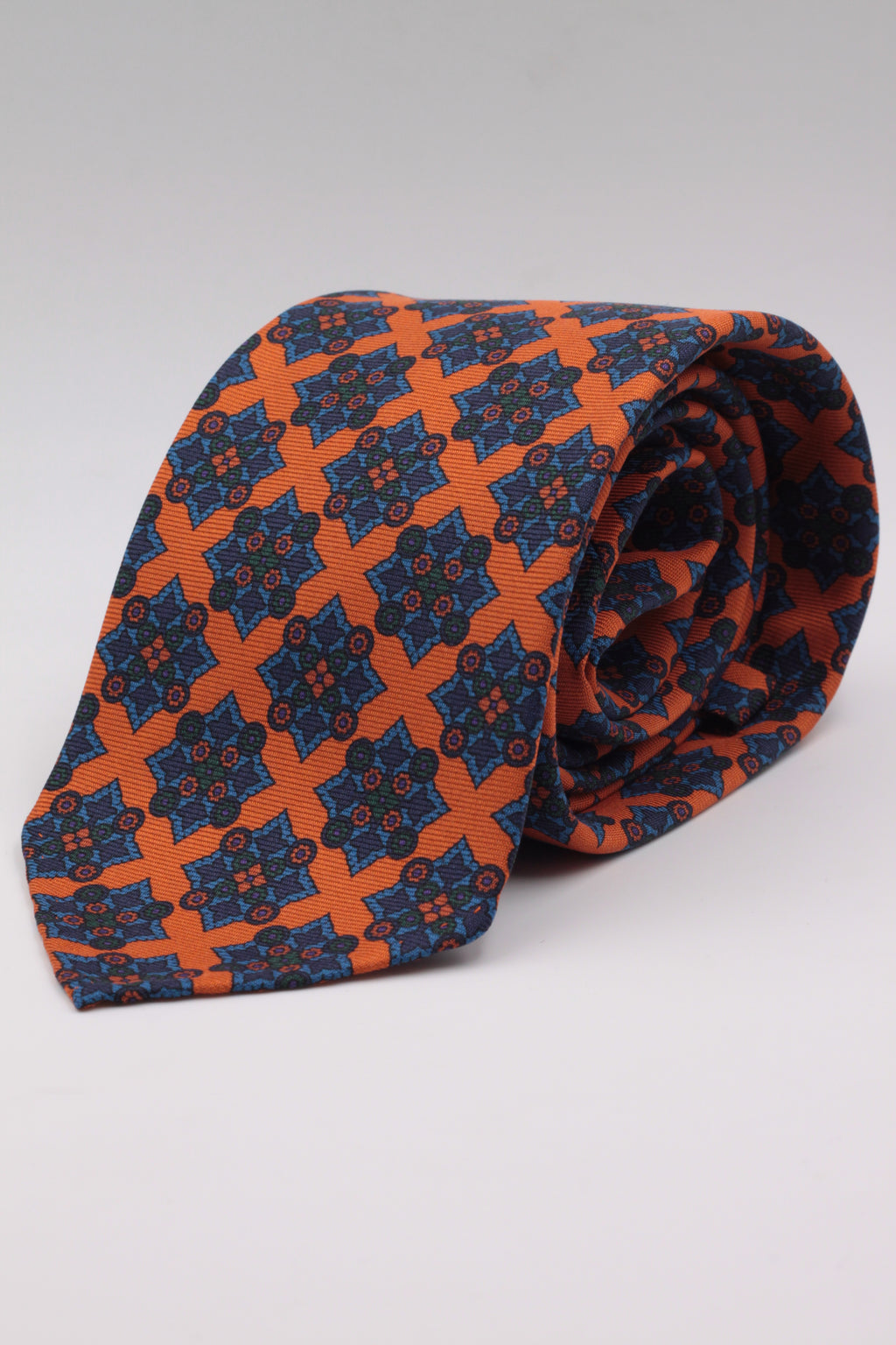 Orange, green, light blue and deep blue medallions tie