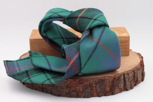 Green, orange, light blue and black tartan tie