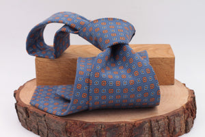 Royal blue, orange and light blue flower print tie