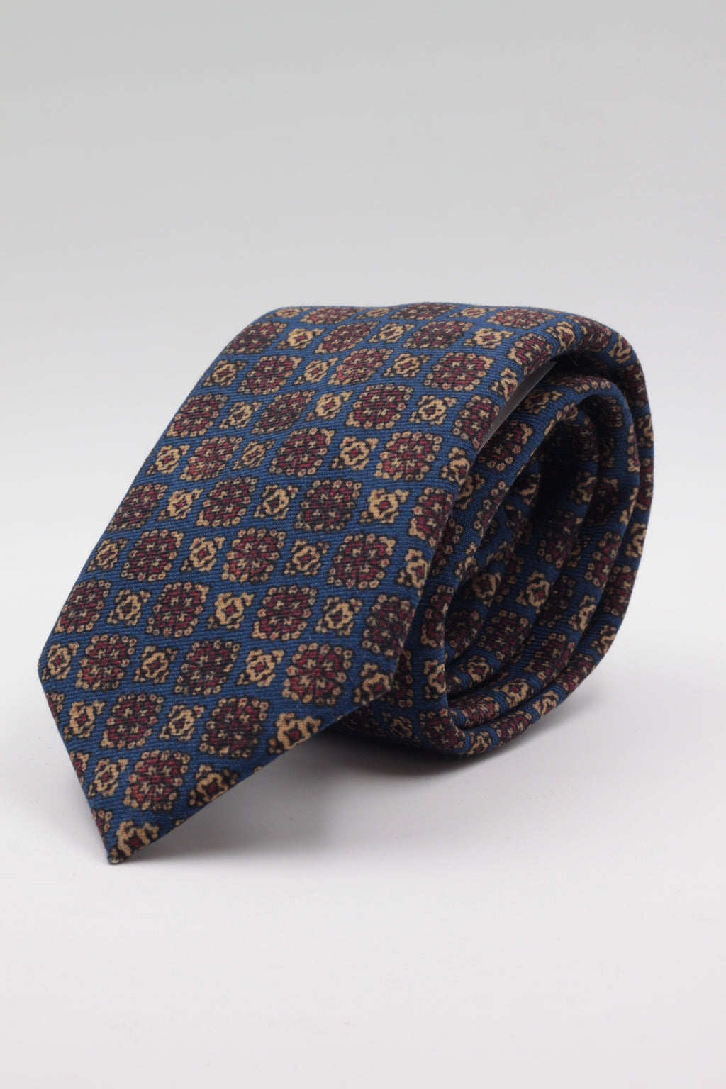Blue, cream and burgundy print tie