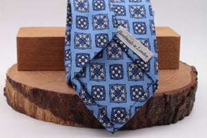 Light blue, white and dark blue motif tie