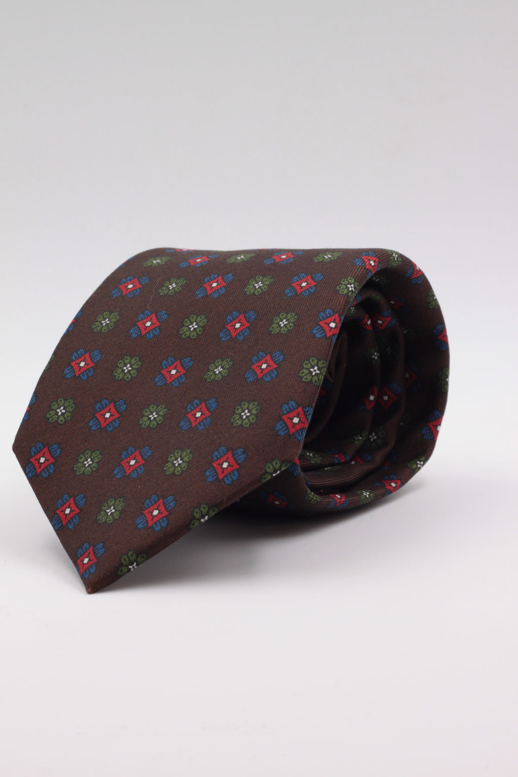 Brown, green, red and royal blue motif tie