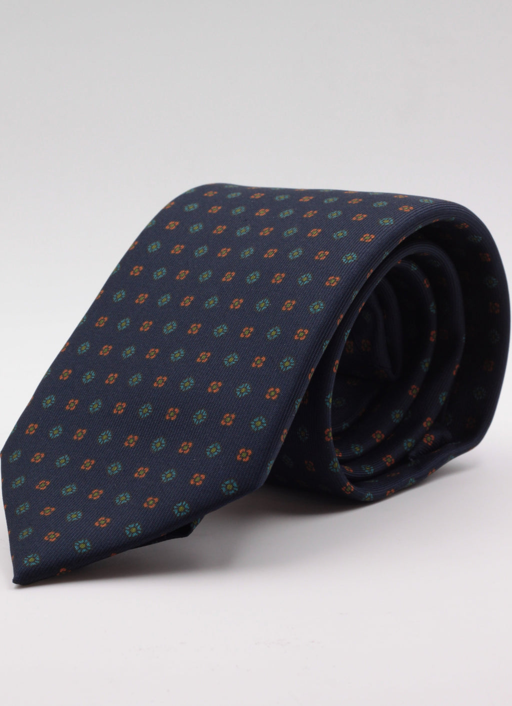 Dark blue, orange, green and turquoise flower motif  tie