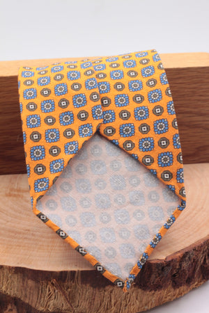 100% Printed Madder Silk  Italian fabric Unlined Light orange, brown, white and light blue motif unlined tie Handmade in Italy 8 cm x 150 cm