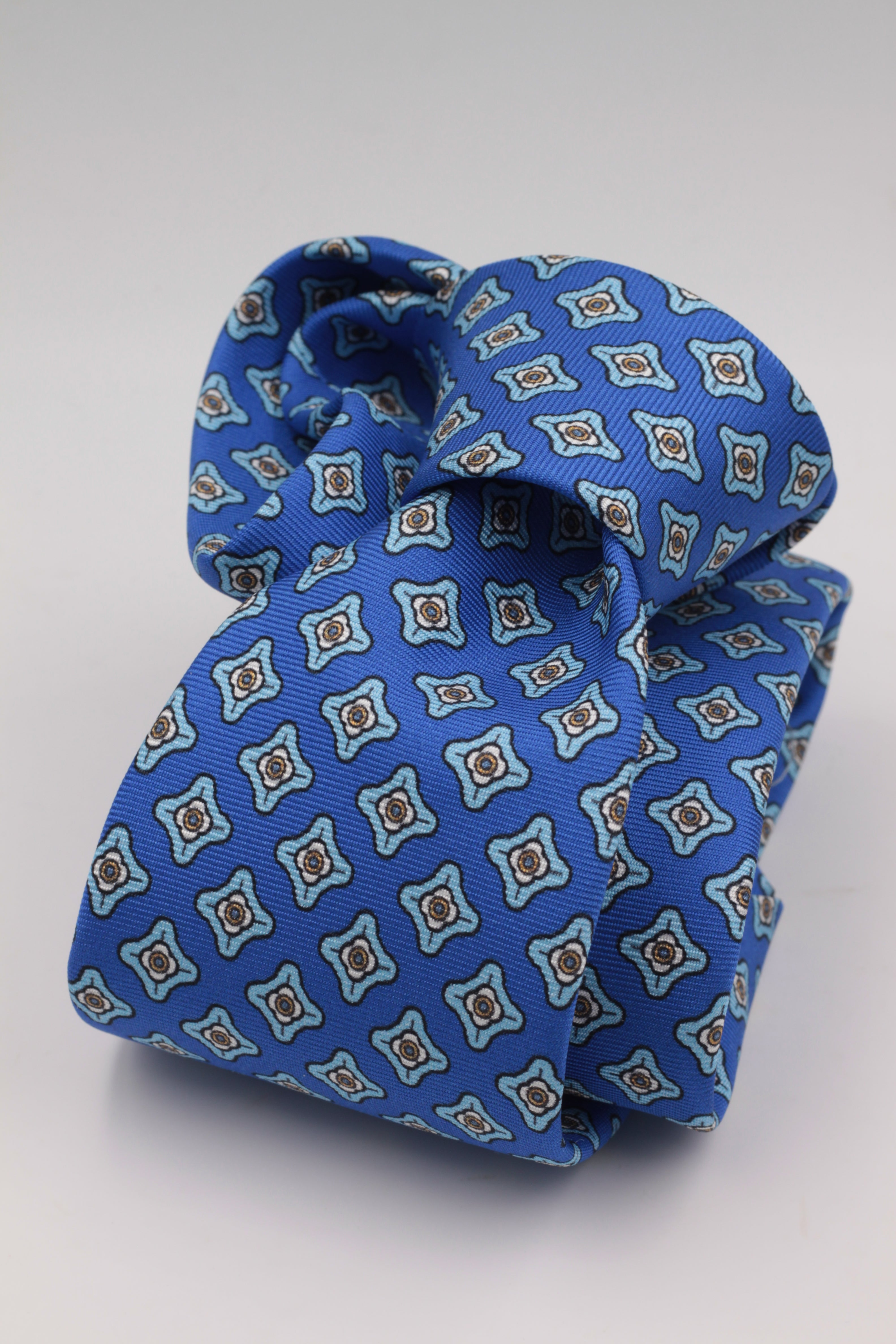 Cruciani & Bella 100% Printed Silk Italian Fabric Self Tipped Royal Blue Light Blue, Khaki and White motif Tie Handmade in Rome 8 cm X 150 cm