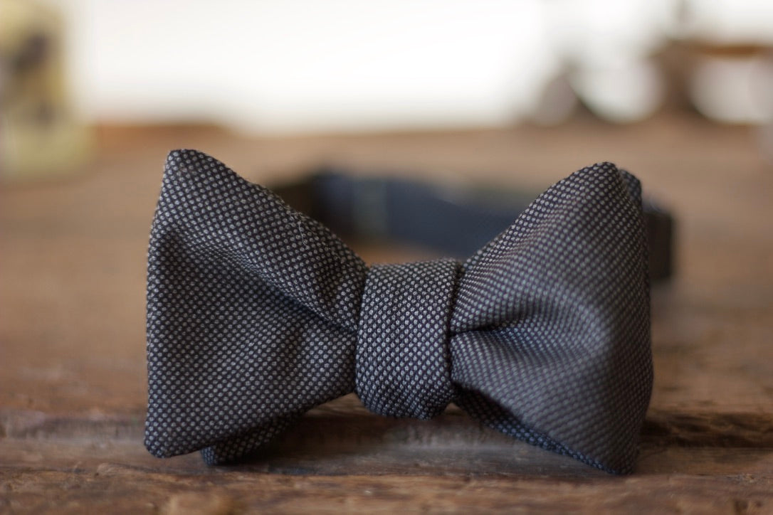 Noodles Bow Ties 100% Wool Charcoal bird's eye Handcrafted in Italy Coated metal hardware  Olive green gabardine inside Hand-stitched labels Handmade boxes Self-tie bow ties