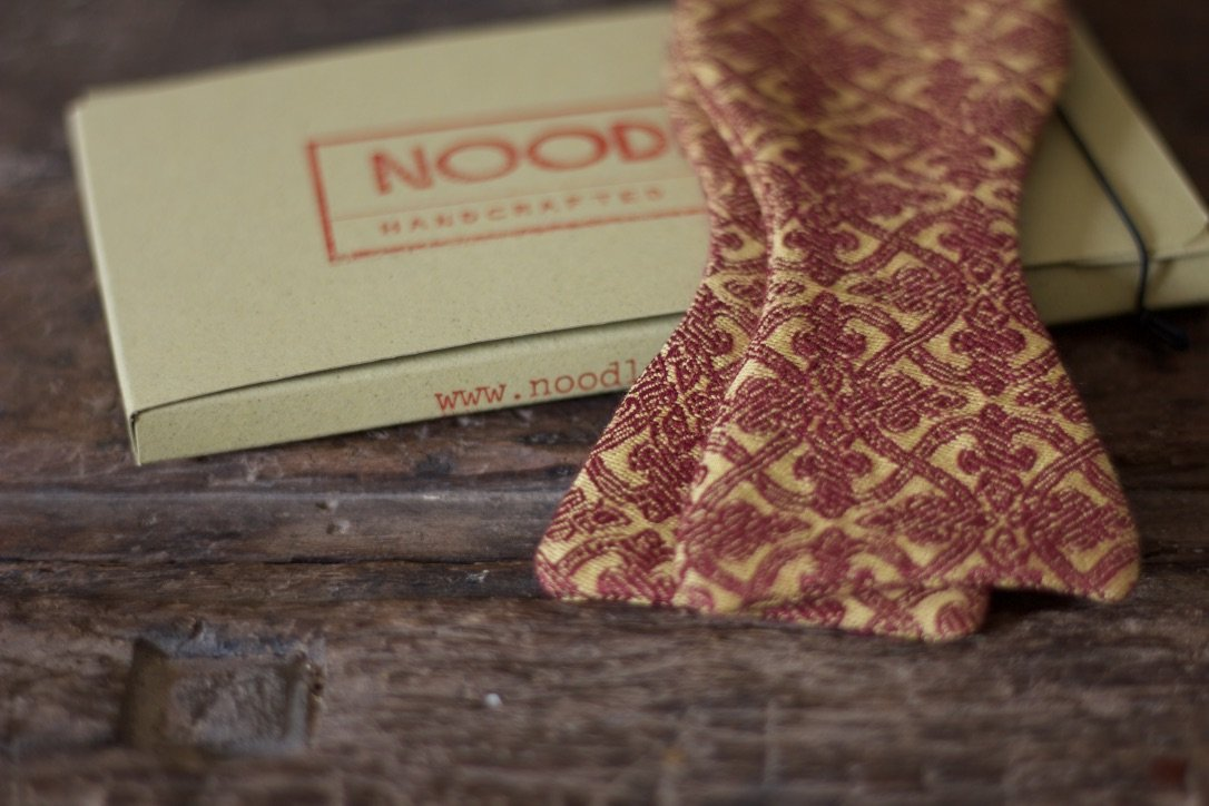 Noodles Bow Ties 100% Cotton  Pompeian red and ocra yellow Handcrafted in Italy coated metal hardware  olive green gabardine inside hand-stitched labels handmade boxes self-tie bow ties