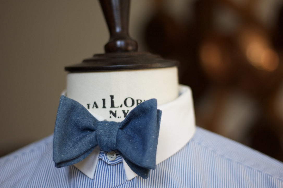 Noodles Bow Ties 100% Cotton Denim Light blue, white pin dots Handcrafted in Italy Coated metal hardware  Olive green gabardine inside Hand-stitched labels Handmade boxes Self-tie bow ties