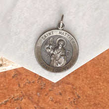 Load image into Gallery viewer, Sterling Silver Antiqued Saint Matthew Round Medal Pendant 31mm, Sterling Silver Antiqued Saint Matthew Round Medal Pendant 31mm - Legacy Saint Jewelry