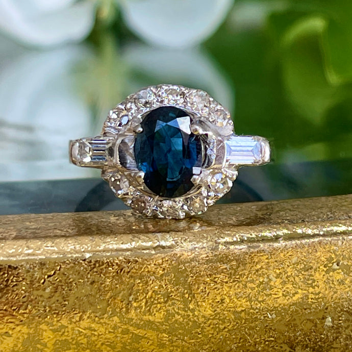 Estate Platinum Art Deco Oval Blue Sapphire + Baguette Diamond Half Halo Ring