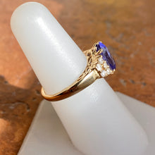 Load image into Gallery viewer, Estate 14KT Yellow Gold Oval Tanzanite + Round Diamond Ring, Estate 14KT Yellow Gold Oval Tanzanite + Round Diamond Ring - Legacy Saint Jewelry