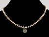 Mauve pearl necklace with silver Ohm (Web-47)