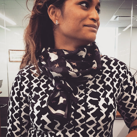 NYC based Shahihdah wearing the Delaney Dinosaur Scarf by Terracotta New York