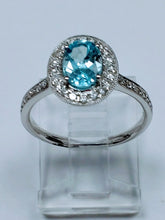 Load image into Gallery viewer, White gold aquamarine and diamond halo ring