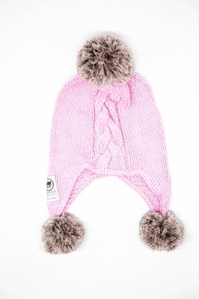 Hand knitted beanie made with organic cotton. Pink beanie with light grey pom poms.