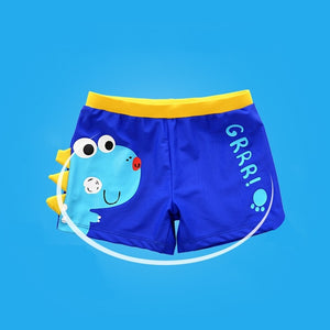 Dinosaurier-Badehose mit Badekappe.