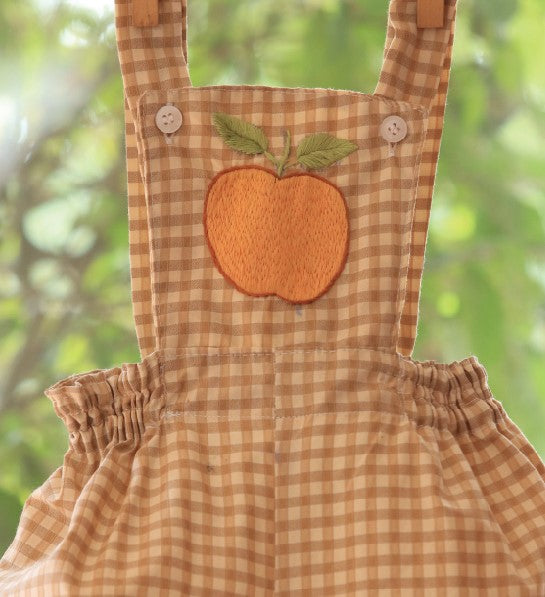 Brown check romper with cross back for little kids by Tara online