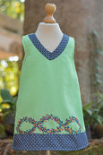 GREEN DRESS WITH POLKA DOTTED V NECK