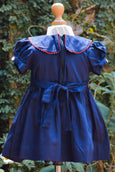 SMOCKED NAVY BLUE DRESS WITH MOTIFS