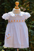 LIGHT FABRIC DRESS WITH YELLOW FLOWER