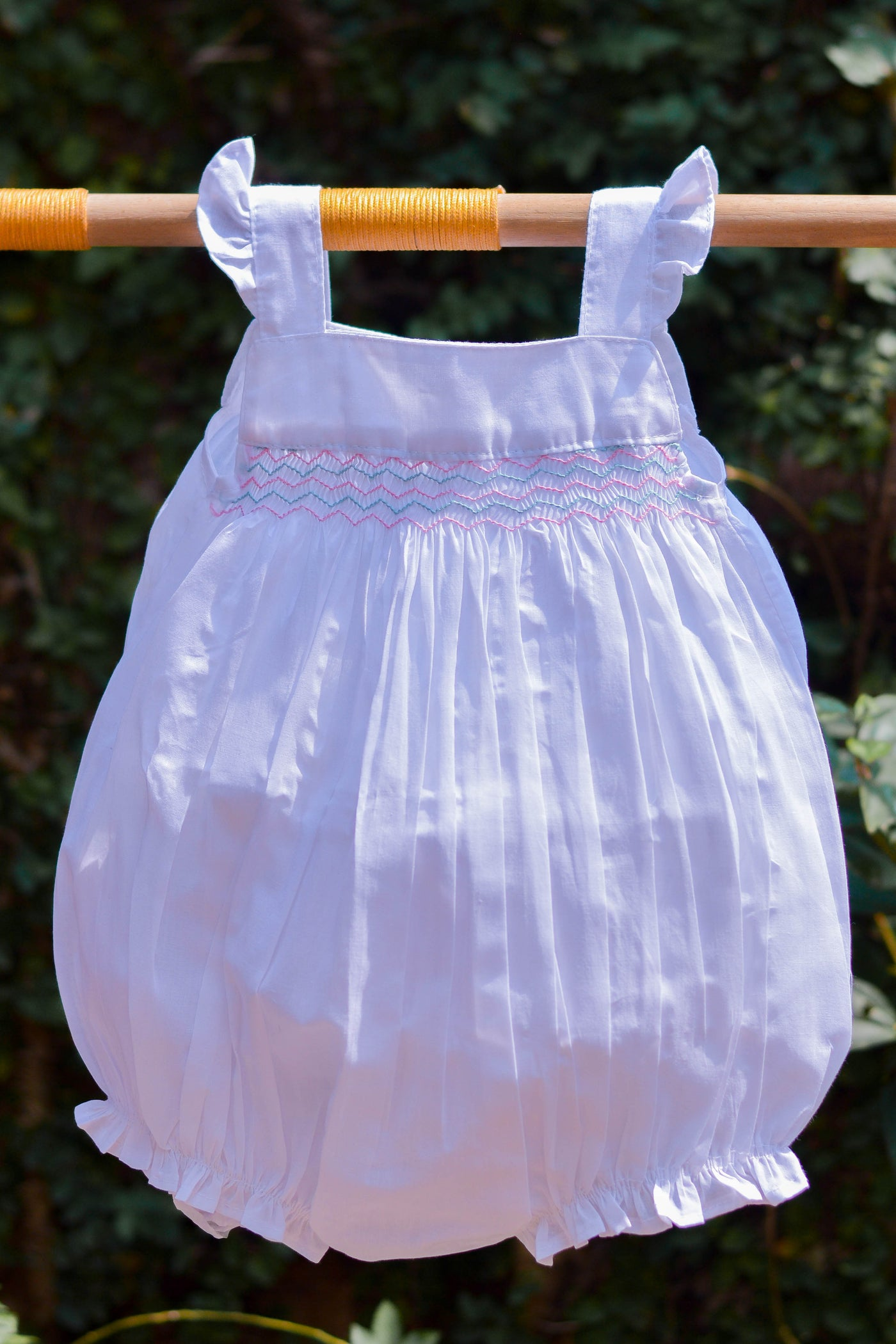 SMOCKED LIGHT FABRIC ROMPER