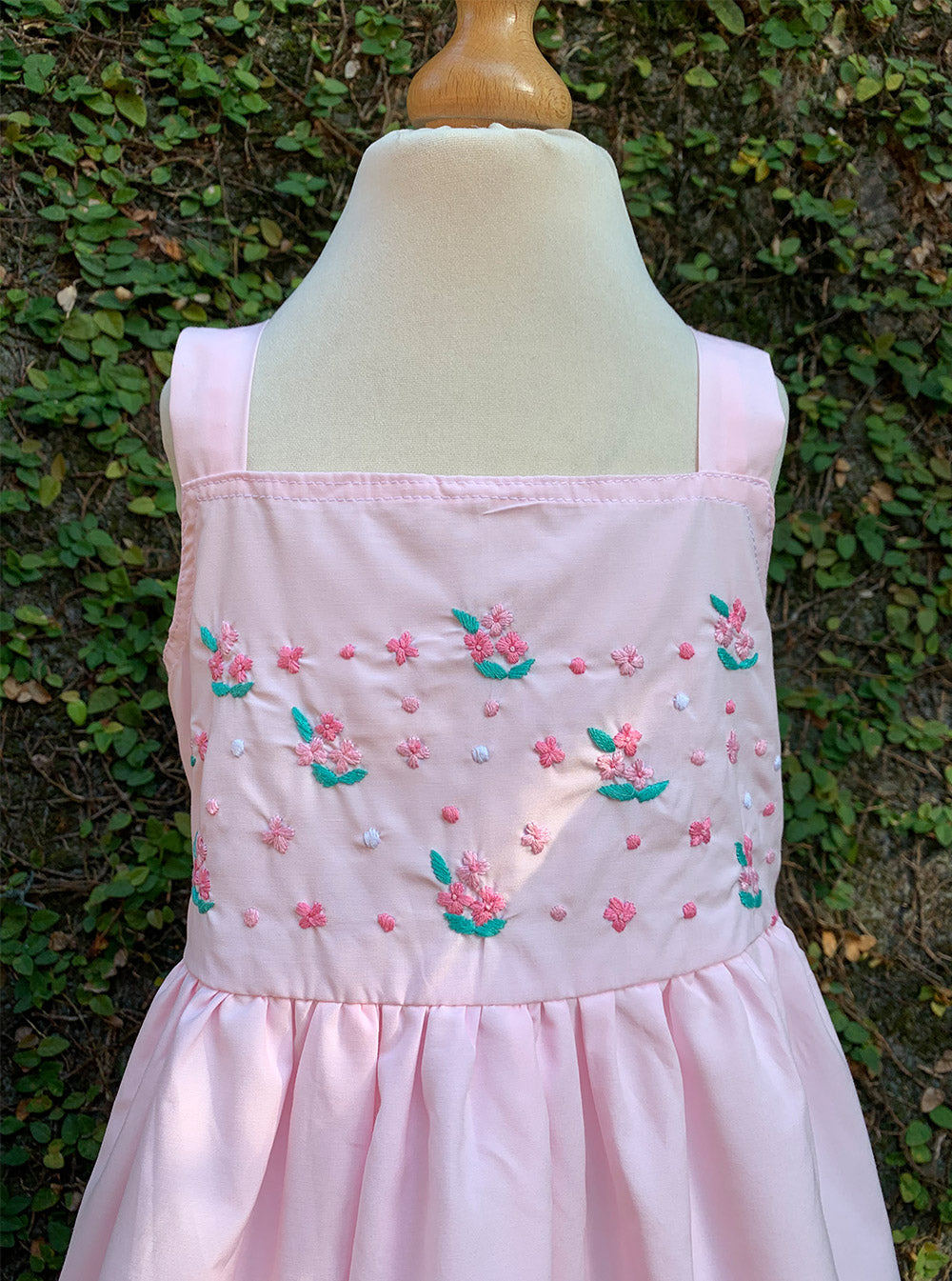 pink embroidered sleeveless dress