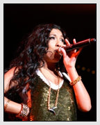 Melanie Fiona Wears the AR-15 Trigger Necklace from the Subversive Gun Collcetion Designed by Dana Walden Chin and Radika Sallick Chin of Dana Walden Jewelry