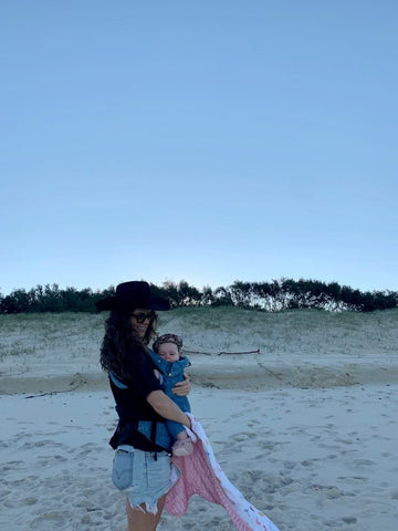 Designer Taryn on the beach in Australia with her daughter