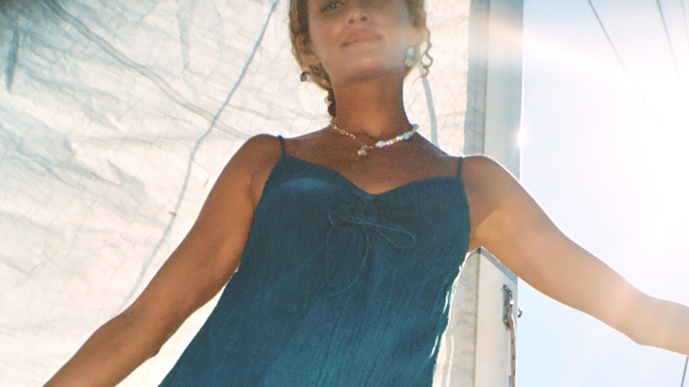 Pearl necklace on summer girl on yacht australia