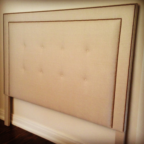 tufted and nailhead trim headboard