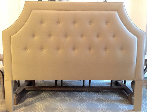 shaped and tufted cream headboard
