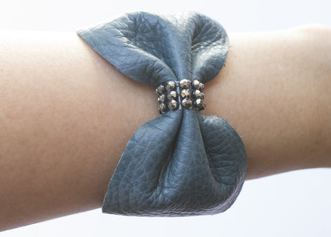 CRYSTAL LEATHER BOW CUFF BRACELET IN JUNIPER