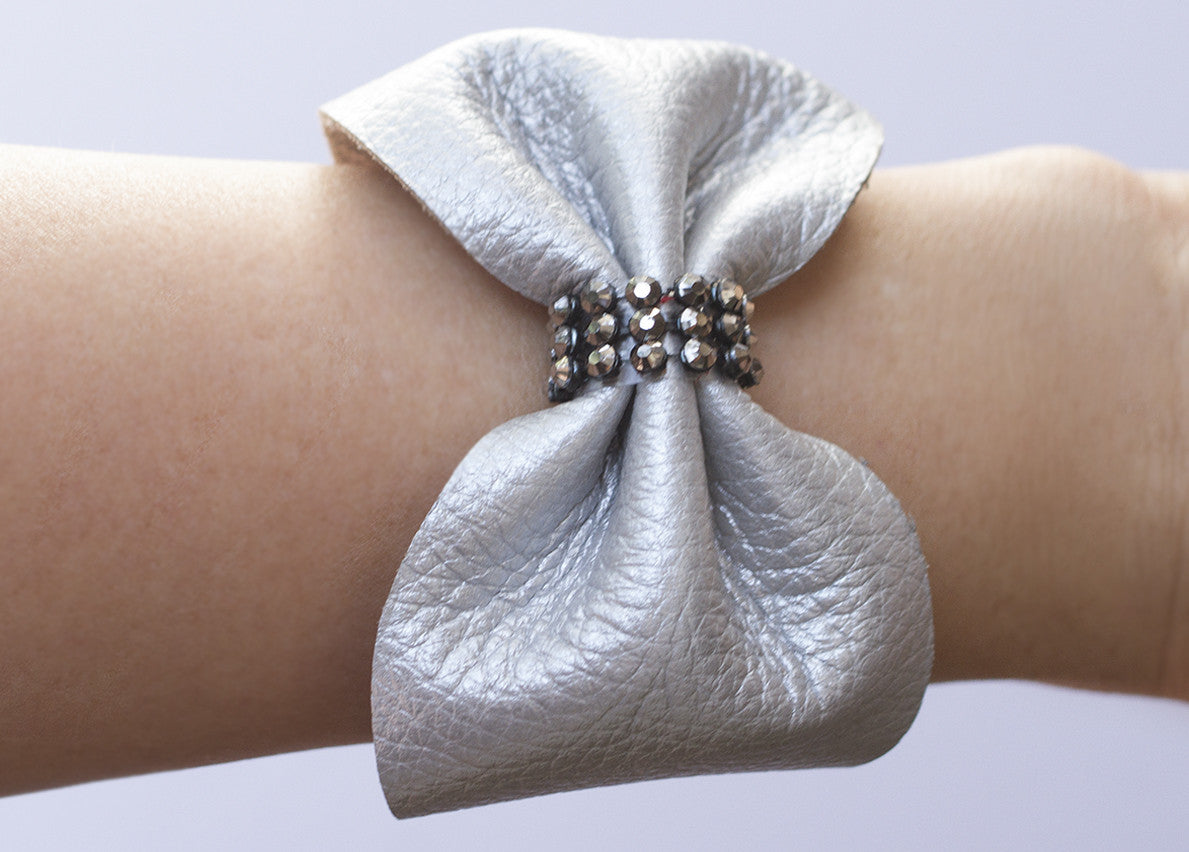 CRYSTAL LEATHER BOW CUFF BRACELET IN SILVER