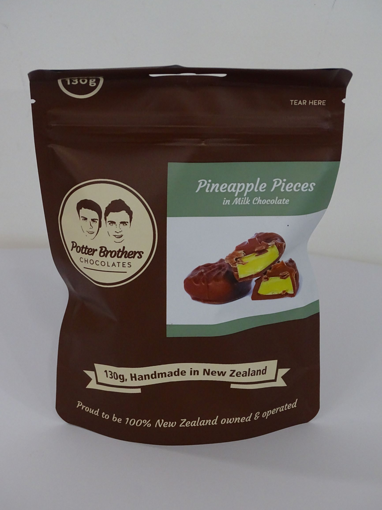 Pineapple pieces in milk chocolate 130g