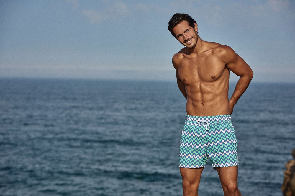 attractive man wearing mens designer board shorts