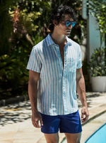 man wearing a whtie summer beach shirt